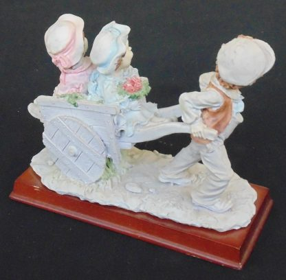 Three children and a wheelbarrow, Statue