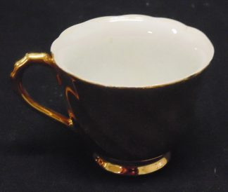 Gold Porcelain Coffee Cup, chipped