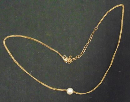 White Bead on Necklace