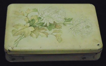 Cream colored Tin with a Flower