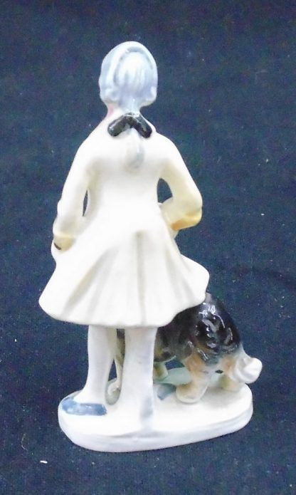 Period Dressed person with Dog Statue